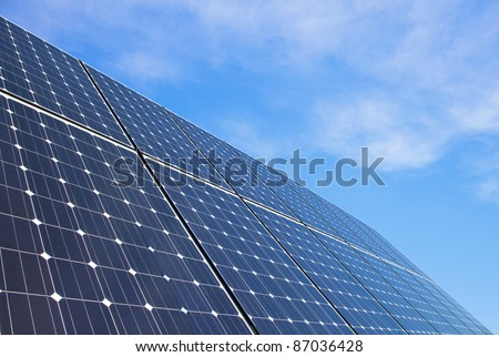 Solar panels against blue sky