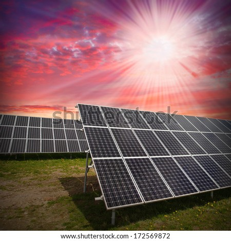 Solar panels against dramatic sky. Sustainable development and renewable resources concept.  - stock photo