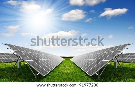 Solar panels against sunny sky - stock photo