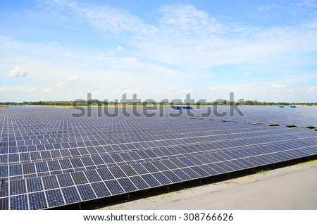 Solar panels against the deep blue sky, Solar farm, Renewable electric energy production - stock photo