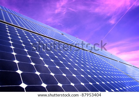 Solar Panels Against The Sky By Sunset