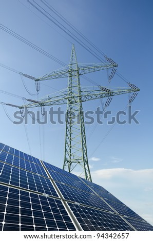 Solar panels and utility pole with wires - stock photo