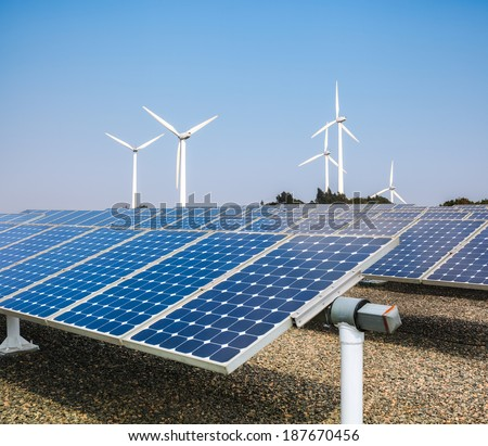 solar panels and wind power ,clean energy background  - stock photo