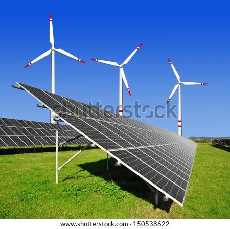solar panels and wind turbine  - stock photo