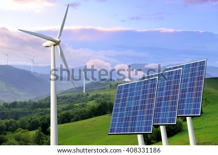 Solar panels and wind turbine on nature background