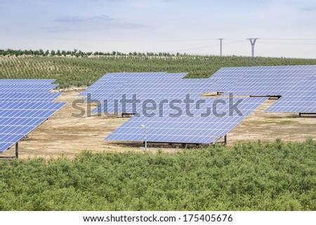 Solar panels as source of renewable ecologic energy - stock photo