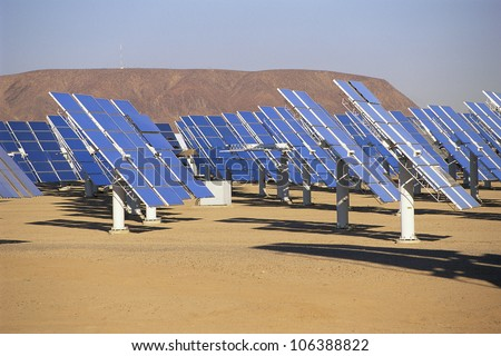 Solar panels at solar energy plant - stock photo