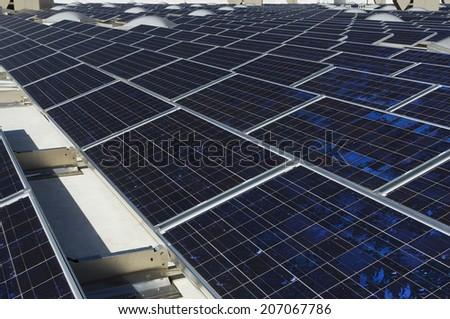 Solar Panels at solar power plant against clear sky - stock photo