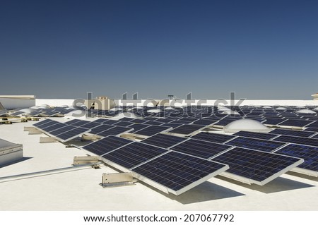 Solar Panels at solar power plant against clear sky - stock photo