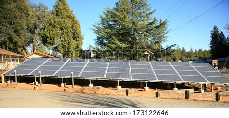 Solar Panels collect sunlight to generate electricity to power equipment and make life easier for all who use power. Solar is a Clean source of electrical energy saves the world from Global Warming. - stock photo