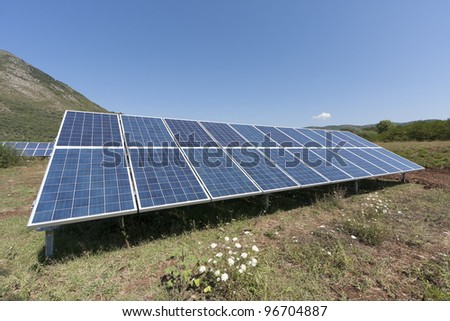 Solar panels in a green field