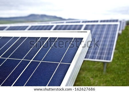 Solar panels in countryside - stock photo
