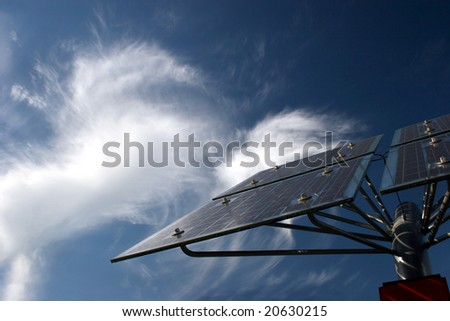 Solar panels in front of bizarre cirrus clouds - stock photo