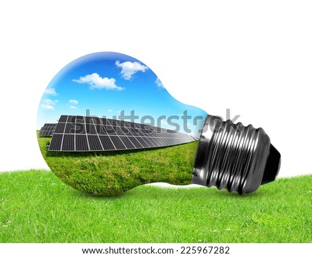 Solar panels in light bulb on white background. Green energy concept.  - stock photo