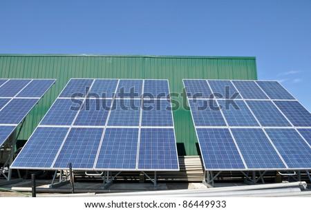 Solar panels in rural setting - stock photo