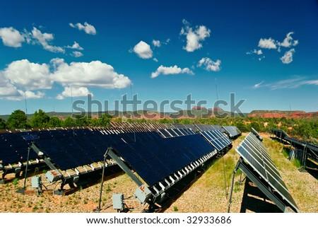 Solar panels in Utah under blue sky - stock photo