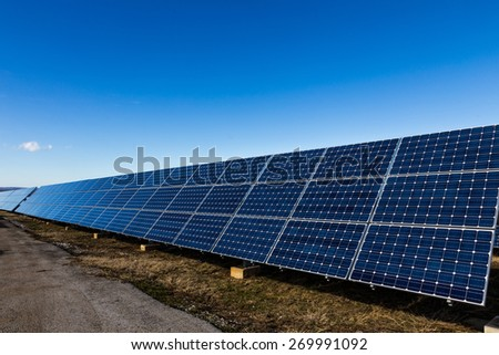Solar panels installation for renewable energy next to road