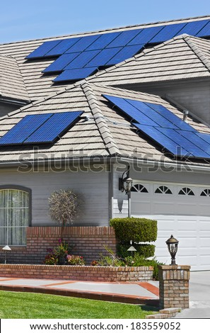 Solar panels installed on the roof of a modern home.  - stock photo