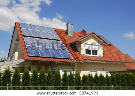 Solar panels on a house roof - stock photo