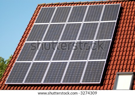 Solar panels on a roof - stock photo
