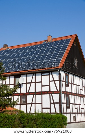 Solar panels on an old house - stock photo