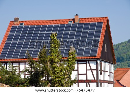 Solar panels on an old timbered house - stock photo