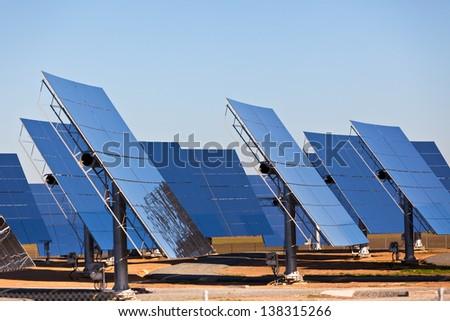 Solar panels on bright blue sky background. Renewable Energy. Horizontal shot - stock photo