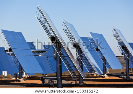 Solar panels on bright blue sky background. Renewable Energy. Horizontal shot