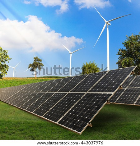 Solar panels on green field with wind turbine