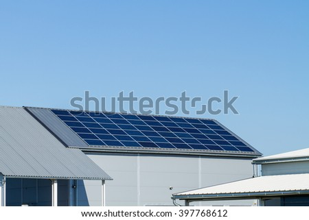 solar panels on large roof, factory building