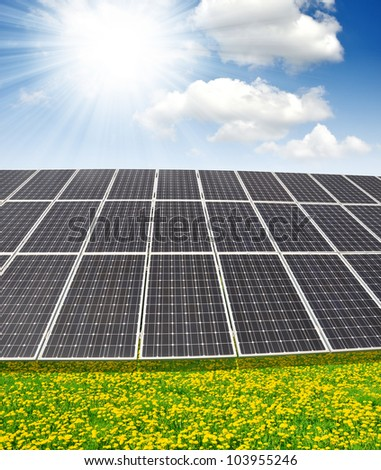 Solar  panels on meadow - stock photo