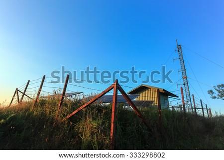 Solar panels on mountain landscape against blue sky. - stock photo