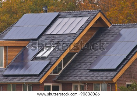 Solar panels on newly build house - stock photo