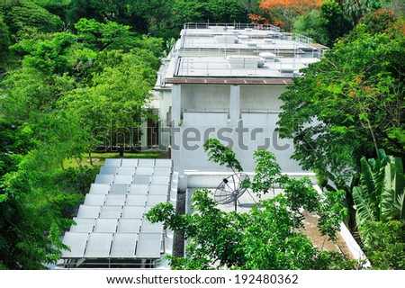 solar panels on roof in urban - stock photo