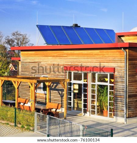 Solar panels on roof of German kindergarten building - stock photo