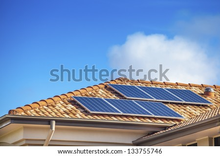 Solar panels on suburban Australian home - stock photo