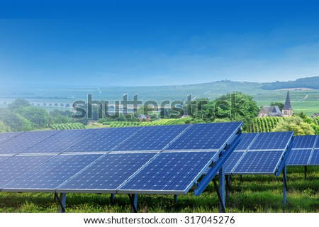 solar panels on summer landscape in France - stock photo