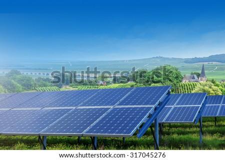 solar panels on summer landscape in France - stock photo