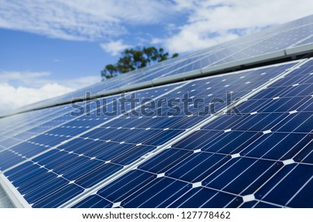 Solar panels on sunny roof - stock photo