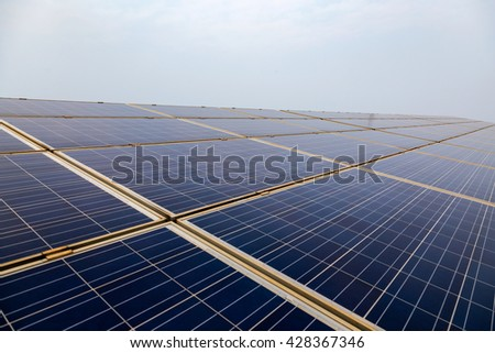 Solar panels on the blue sky background