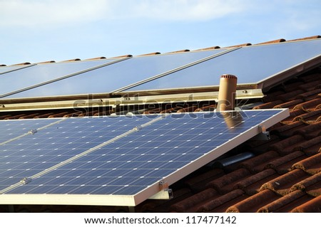 Solar panels on the roof of a private house - stock photo
