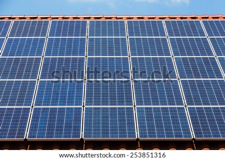 solar panels on the roof, symbol, l for alternative energy, ecology, sustainability - stock photo
