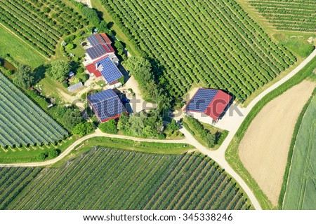 solar panels on the roofs of rural houses in Germany - stock photo