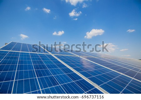 Solar panels on the sky background. Solar power plant. Blue solar panels. Alternative source of electricity.
