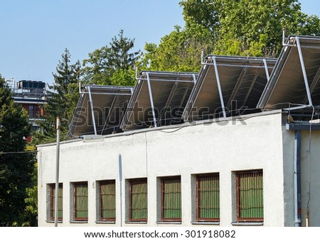 Solar panels on the top of a building rear view