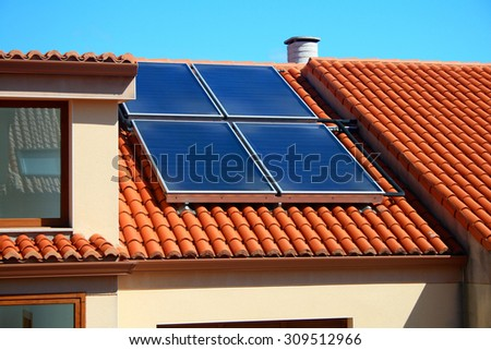 Solar panels over a home roof.