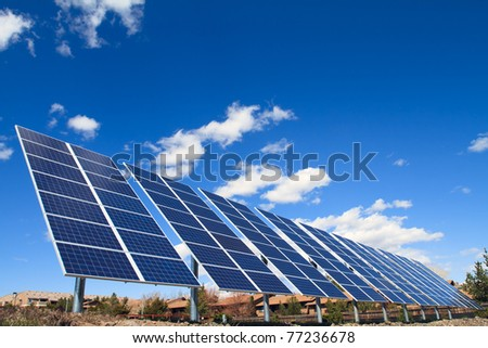 solar panels over blue sky - stock photo