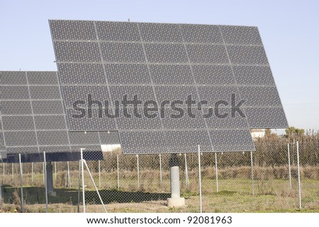 Solar panels placed in a row or orchard - stock photo