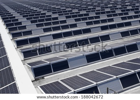 Solar panels roof of an industrial building - stock photo