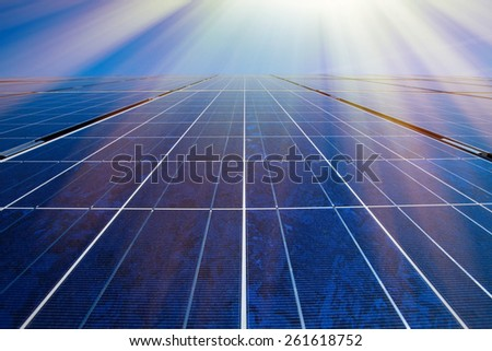 Solar panels, sun and blue sky - stock photo